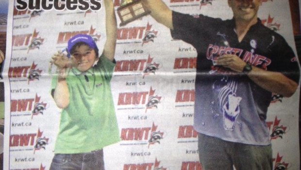 Paul and Derek Leger celebrating their victory at the Kapuskasing River Walleye Tournament.  Photo form the cover of the Northern Times.